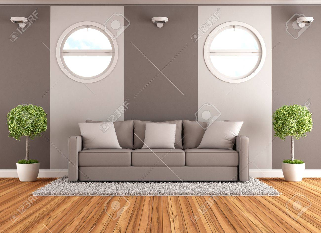 Contemporary living room with brown couch and round windows - rendering Stock Photo - 21538746