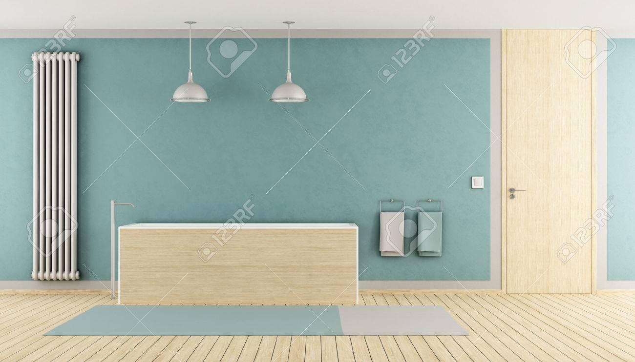 Minimalist Blue Bathroom With Wooden Bathtub, Radiator And Closed ...