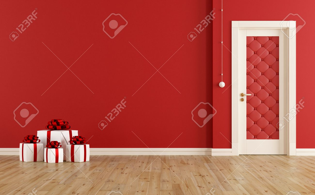 Chambre rouge avec la porte fermée et le présent de noël sur ...