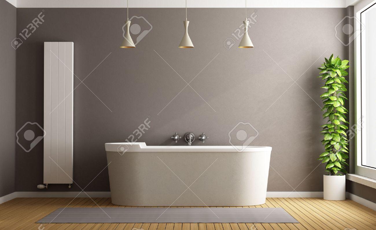 Minimalistisk badrum med elegant badkar, vertikal värmare och växt ...