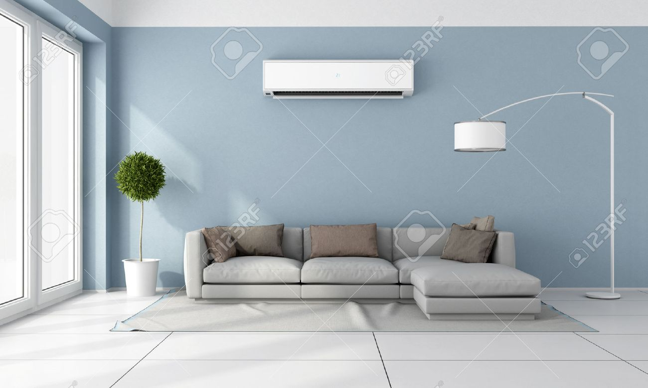 Blue living room with gray sofa and air conditioner on wall..