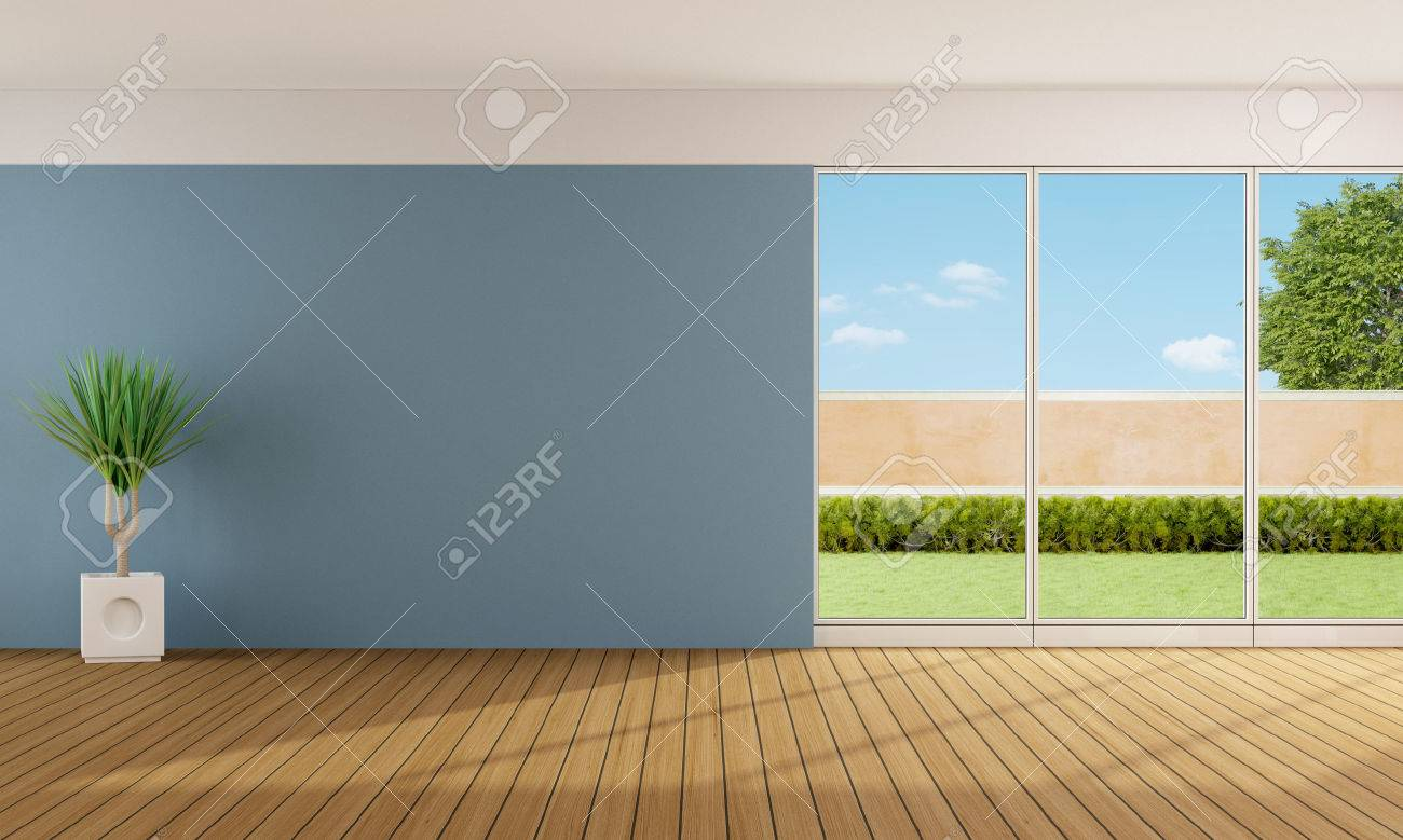 Empty Living Room With Blue Wall And Large Windows 3D Rendering Stock Photo