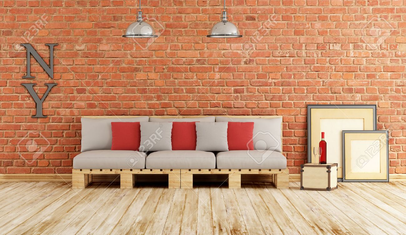 Living room with pallet sofa on old wooden floor and brick wall - 3D Rendering Standard-Bild - 44701604