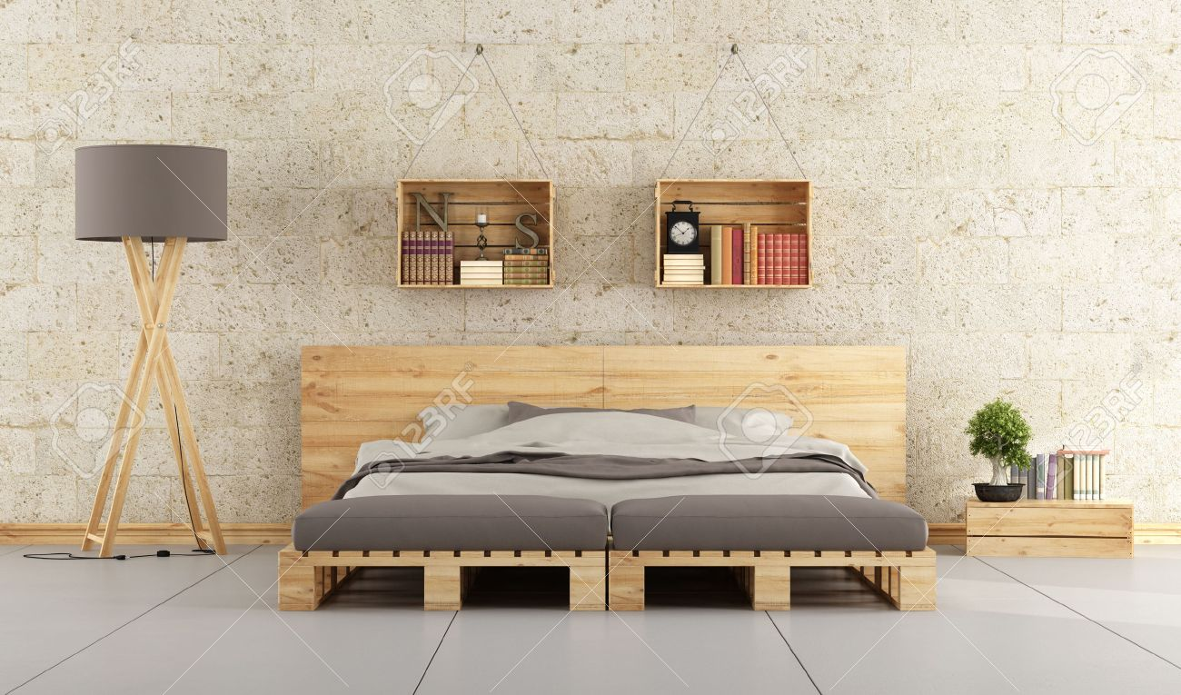Modern bedroom with bed pallet on brick wall Standard-Bild - 44702115