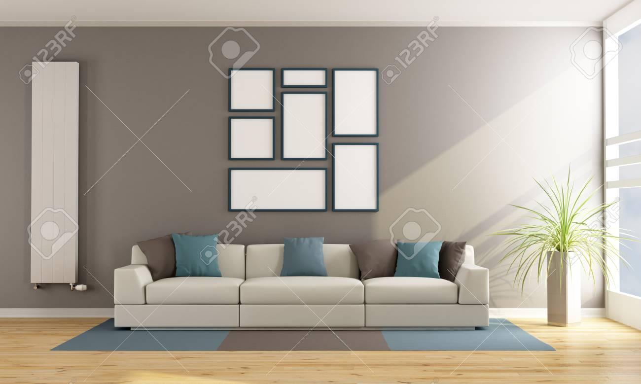 Moderne Wohnzimmer Mit Sofa, Vertikale Heizkörper Und Leere Rahmen An Der  Wand   3D