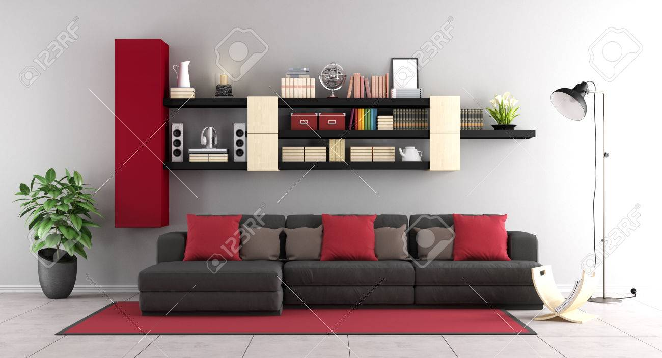Contemporary living room with black sofa and wall unit on background..