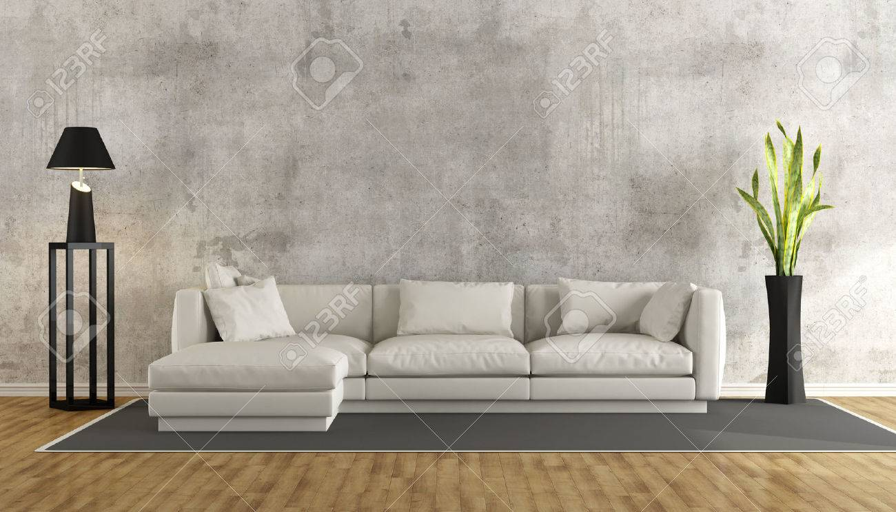 Minimalist living room with grunge concrete wall and white sofa..