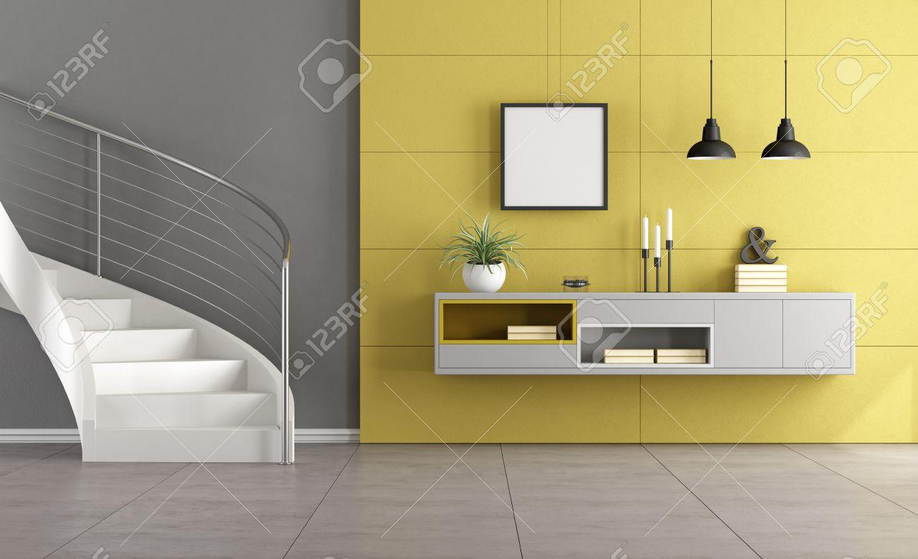 blanco de la escalera en un saln minimalista con aparador de color gris en la pared