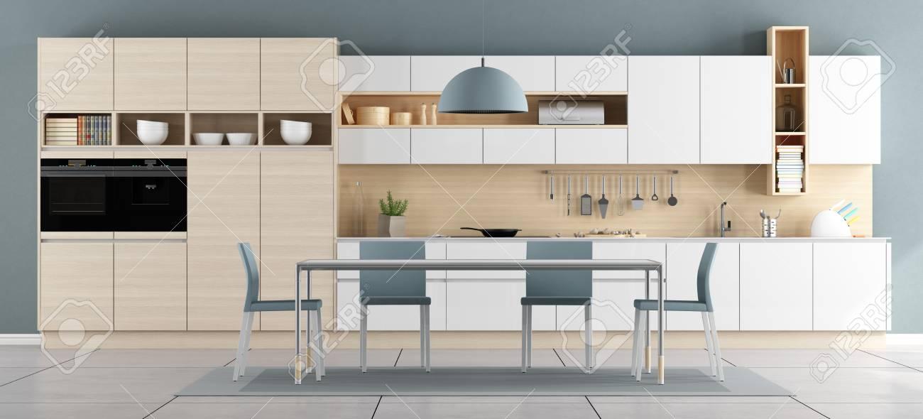 Cocina moderna azul y blanca con la mesa de comedor y las sillas -  representación 3d