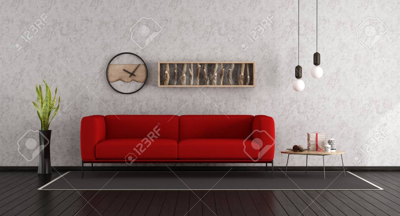 Minimalist living room with red sofa and dark wooden floor -..
