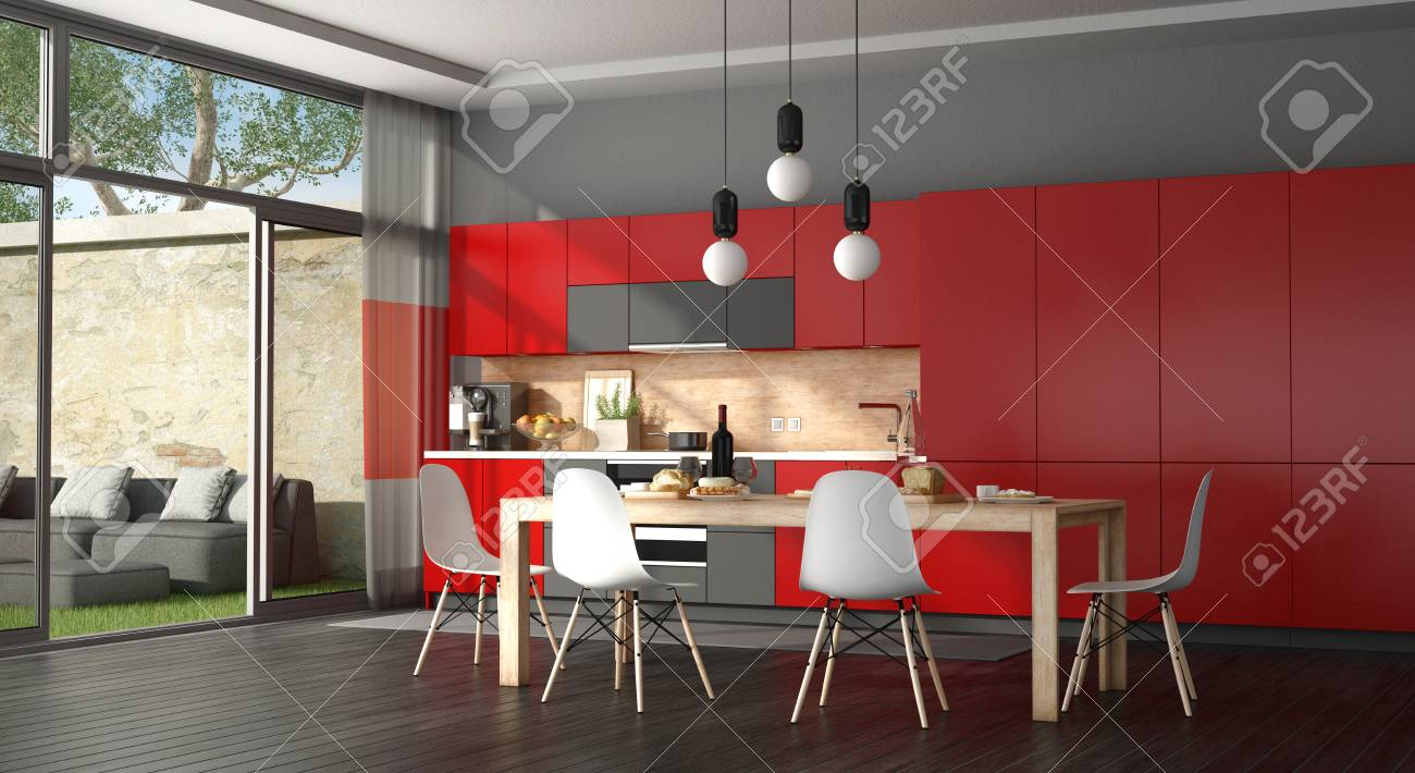 Black And Red Modern Kitchen With Dining Table Sofa In The Stock Photo Picture Royalty Free Image 96628327