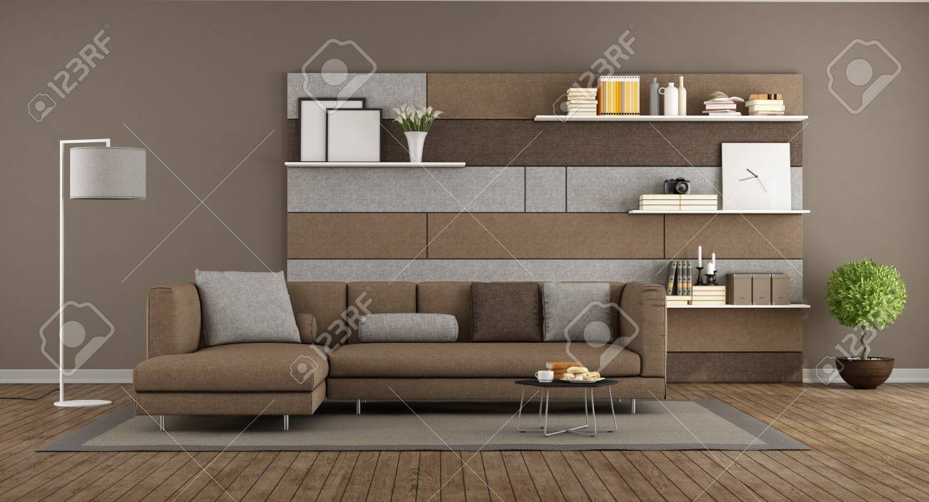 Modern Brown And Gray Living Room With Sofa And And Fabric Panel Whit  Shelves On Background