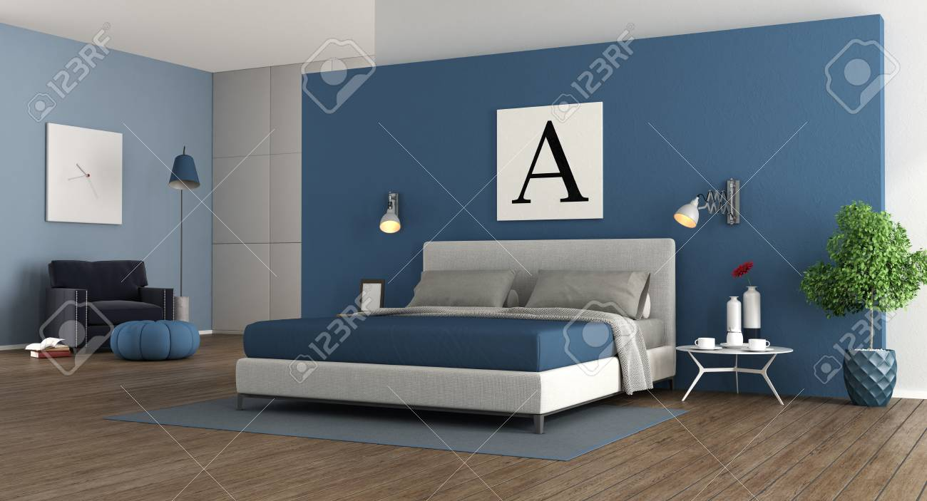Blue modern master bedroom with double bed.wardrobe and armchair..