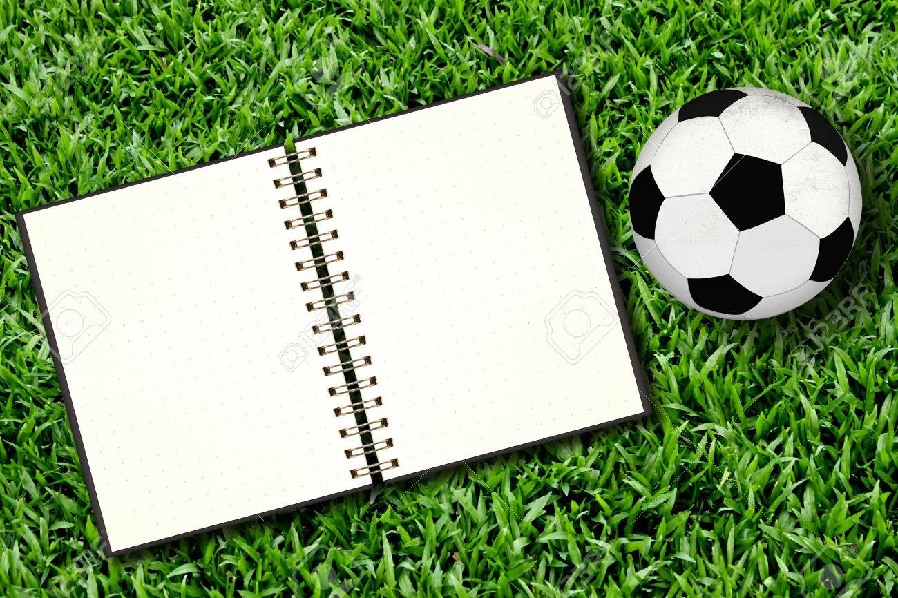 Football and blank notebook on Green Grass Stock Photo - 10507377