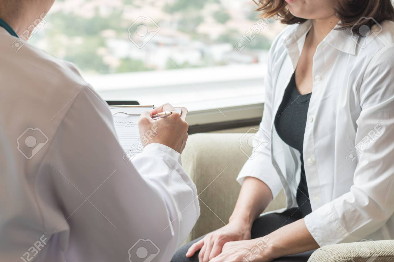 Doctor (obstetrician, gynecologist or psychiatrist) consulting and diagnostic examining woman patient's obstetric - gynecological health in medical clinic or hospital healthcare service center - 111200827