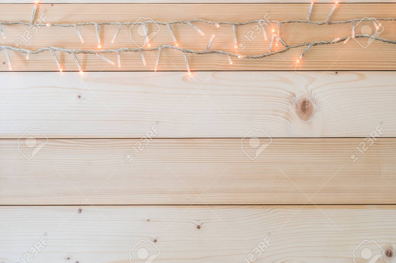 more photos eaa98 8b74b Christmas fairy lights bunting on a white wooden background for..