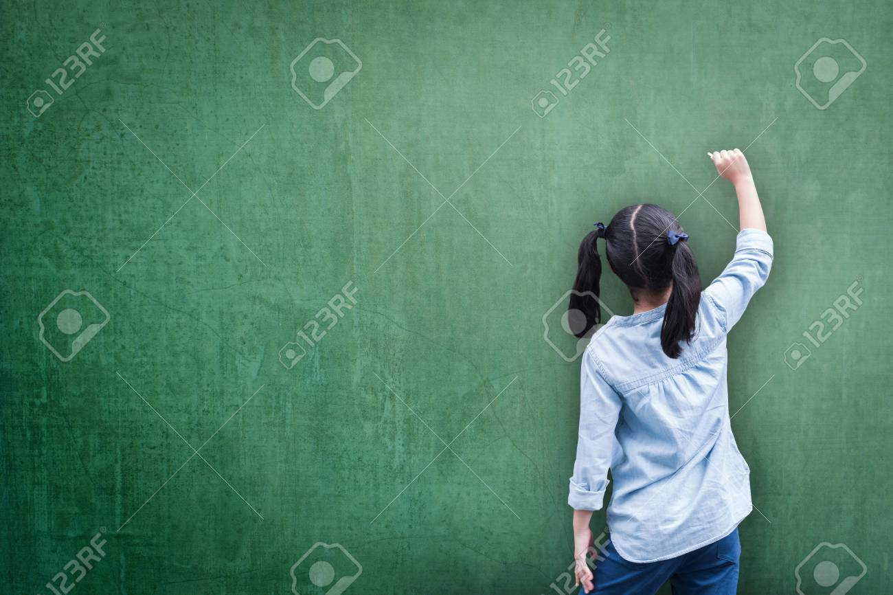 Blank green classroom chalkboard background with student kid back view writing on board - 111611272