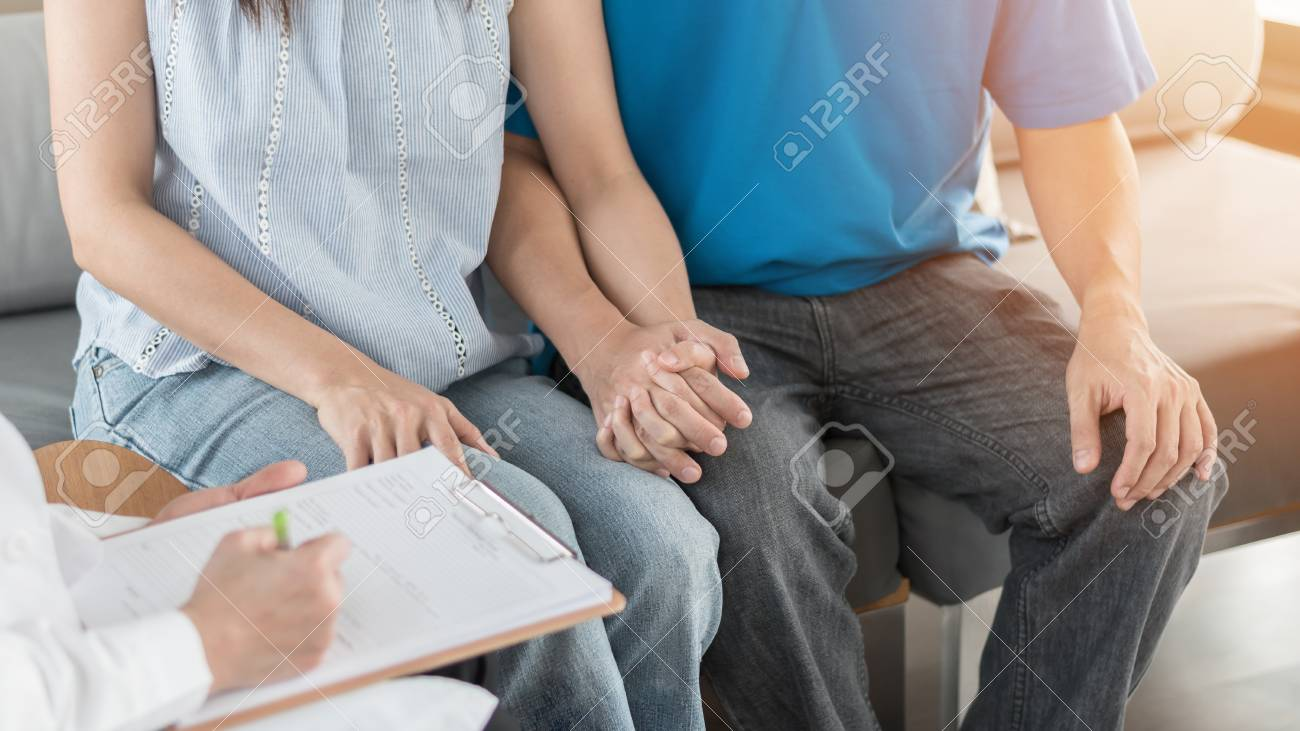 Patient couple consulting with doctor or psychologist on family men and women's medical healthcare therapy, In vitro fertility IVF treatment for infertility, or STD health concept - 113089077