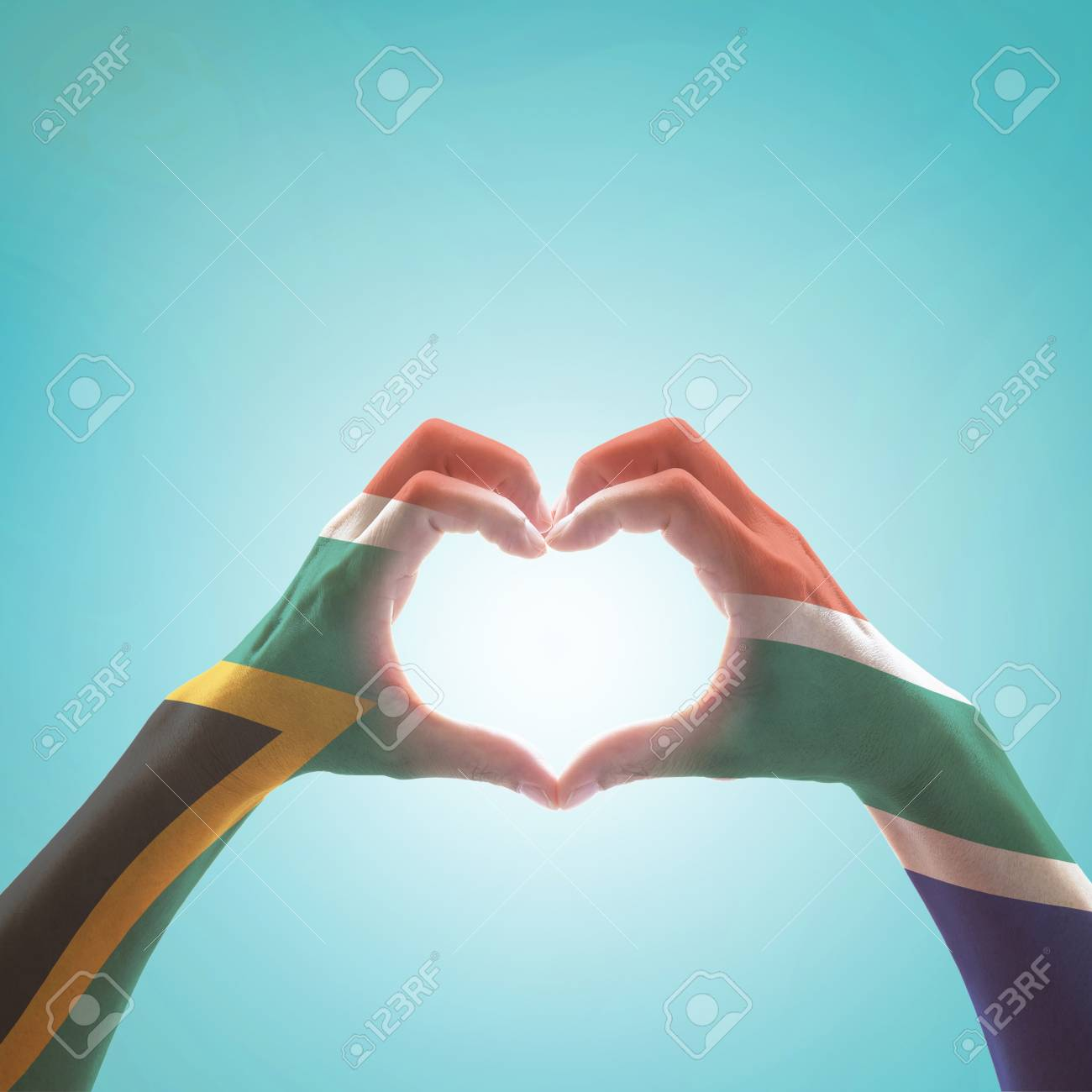 South Africa flag on woman hands in heart shape isolated on mint background for national unity, union, love and reconciliation concept - 116068391