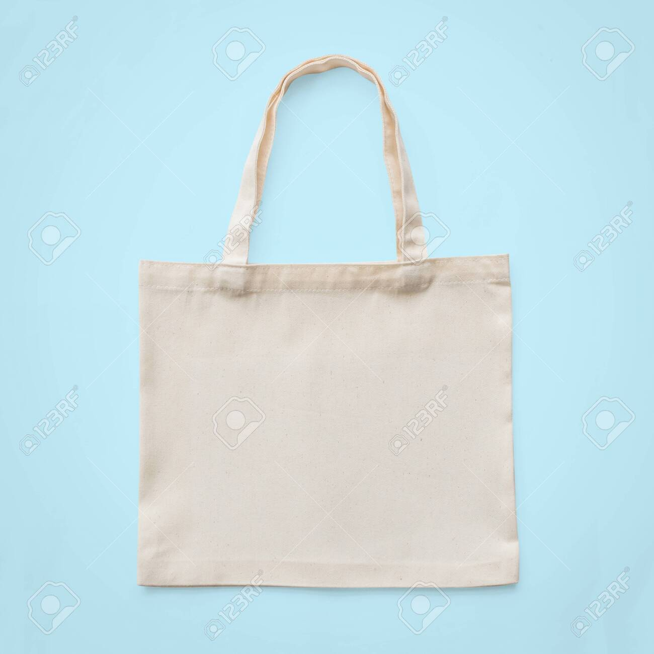 Tote bag mock up canvas white cotton fabric cloth for eco shoulder shopping sack mockup blank template isolated on pastel blue background (clipping path) - 120720329