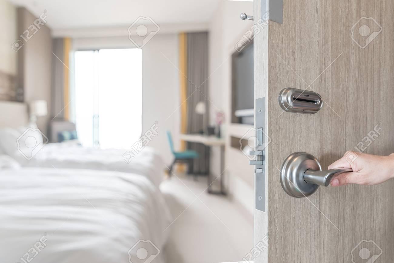 Hotel Room Door Opened Unlock To Guest Bedroom Interior View