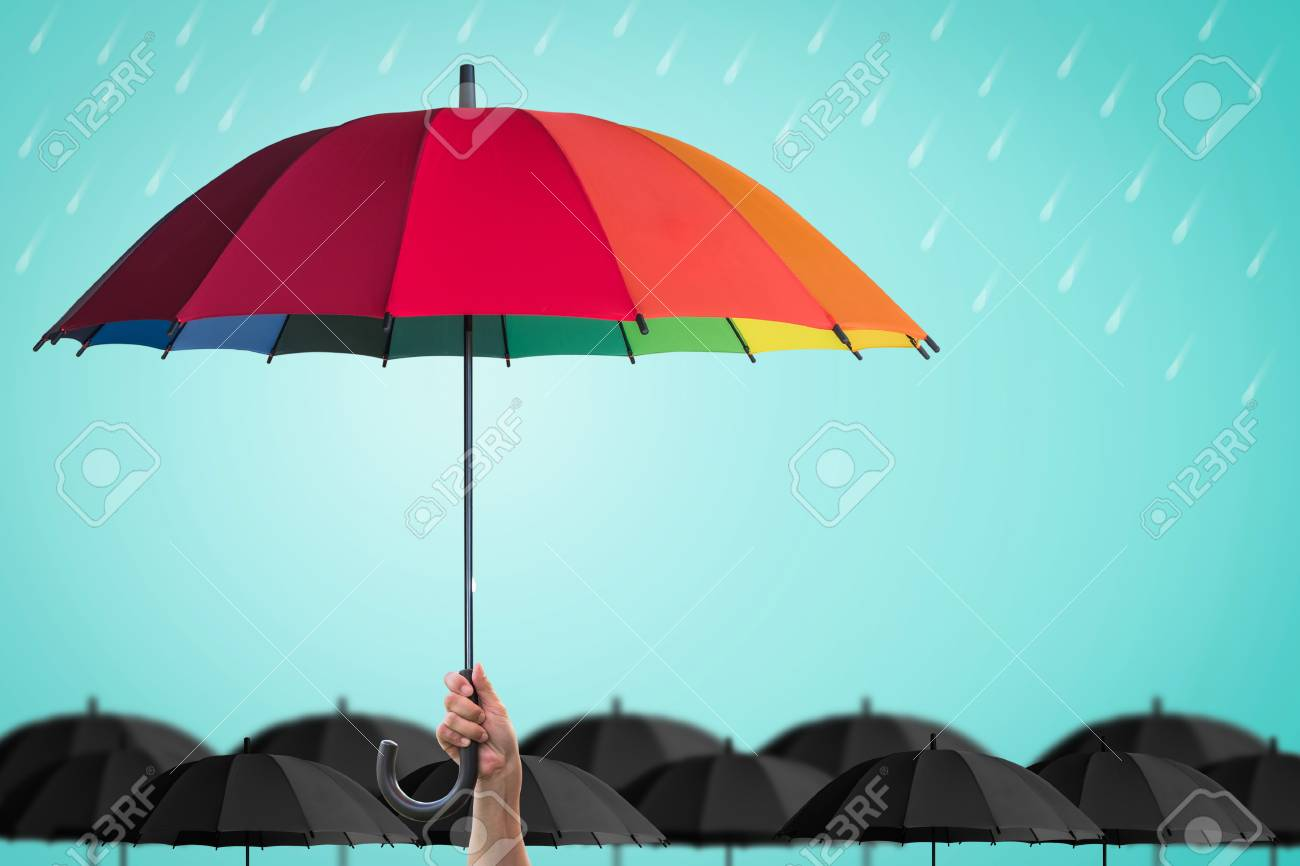 Life-health Insurance protection, business financial leadership concept with leader's hand holding rainbow umbrella distinctively unique - 124859321