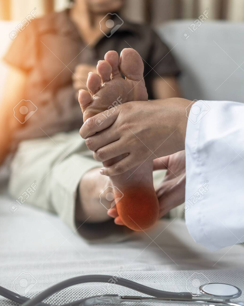 Plantar Fasciitis or heel pain illness in feet of woman patient who having medical exam with orthopaedic doctor on aching tendon, inflammation or disorder of the connective tissue on foot and toe - 129084900