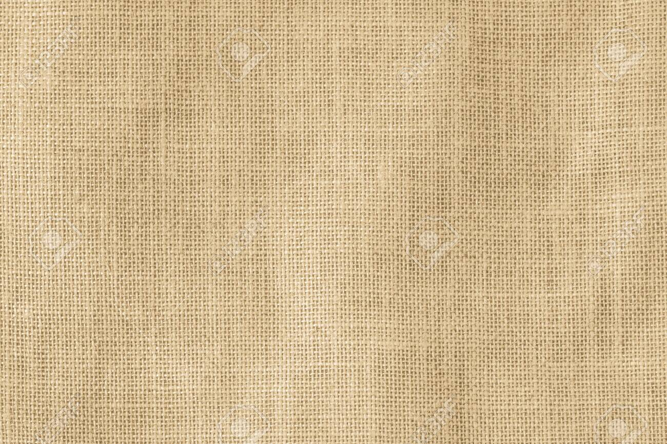 Hessian sackcloth woven texture pattern background in light cream yellow beige earth tone color - 131548915