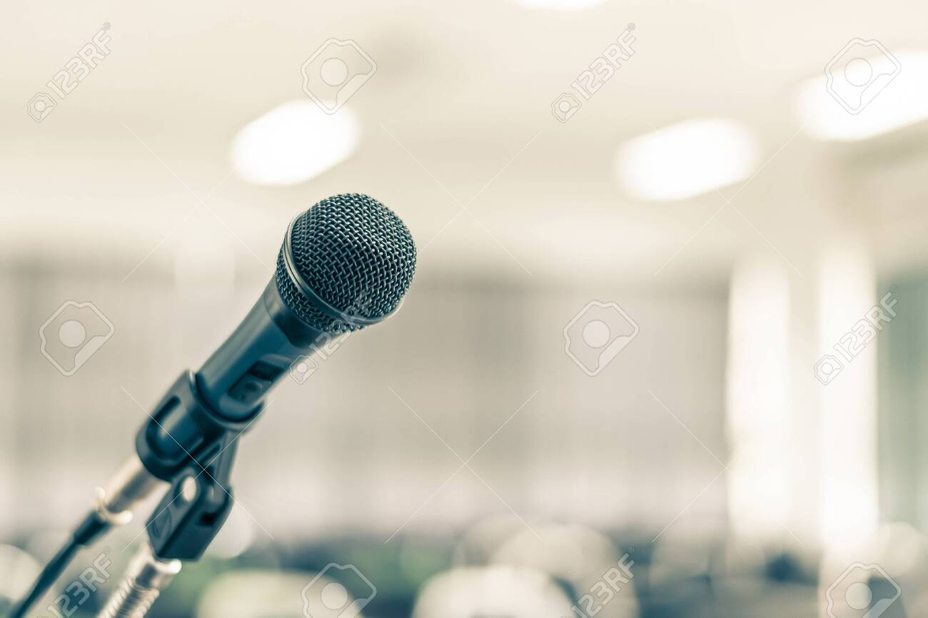 Microphone speaker for seminar or conference meeting in educational business event - 132157407