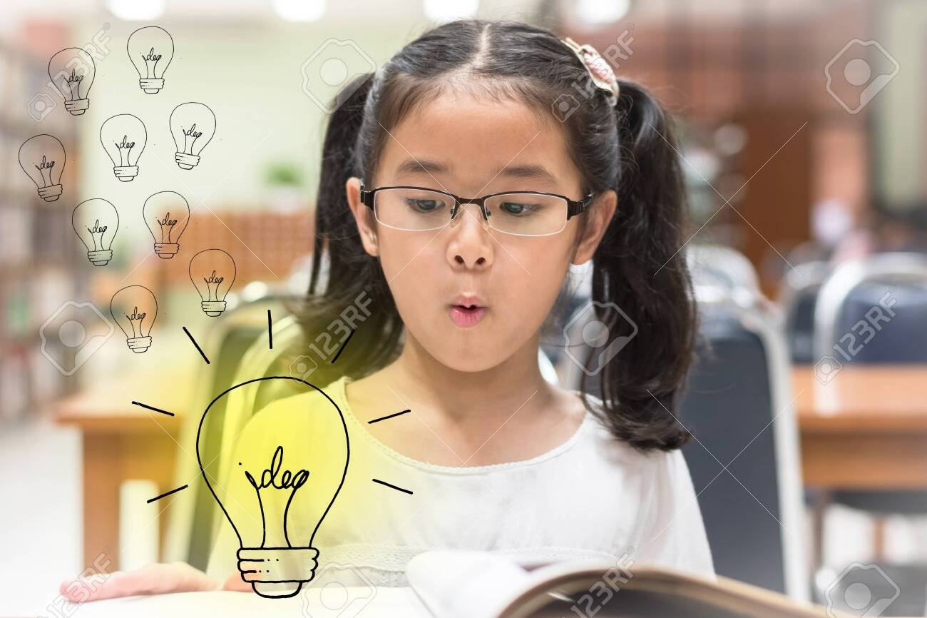 Innovative creative idea for copyrights law concept with kid surprised reading book with lightbulb in library - 133811847