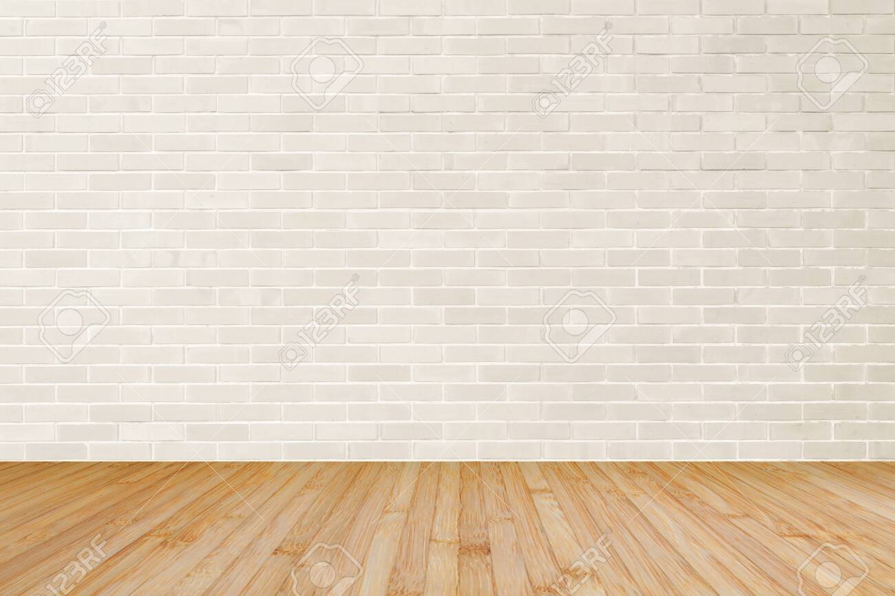 Cream brown brick wall textured background with wooden floor in yellow brown for interiors - 135535596