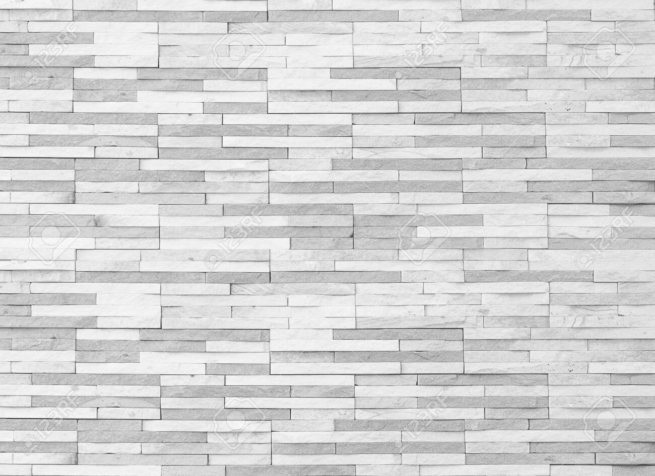 Brick tile wall texture pattern background in white grey color - 135266367