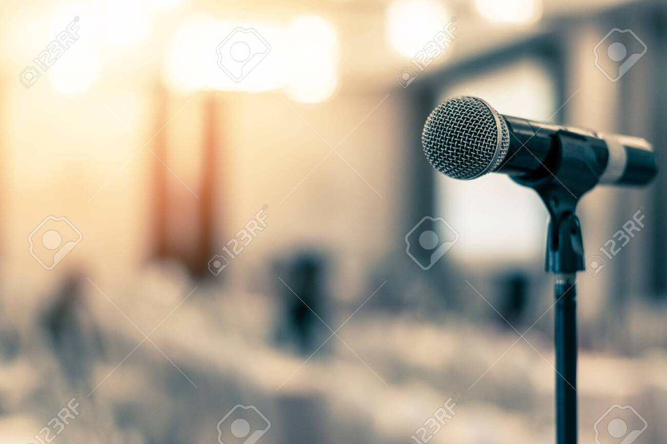Microphone voice speaker in business seminar, speech presentation, town hall meeting, lecture hall or conference room in corporate or community event for host or townhall public hearing - 143606451