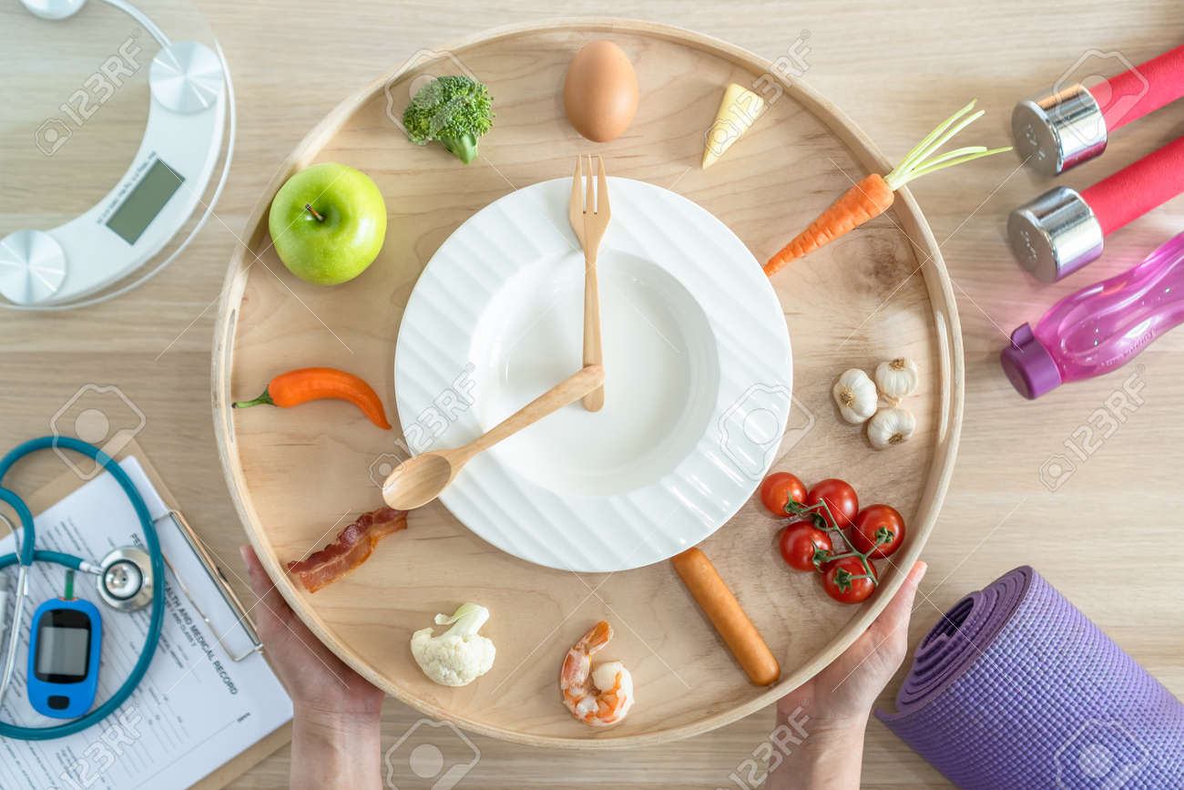 Intermittent fasting IF diet concept with 16:8 hour clock timer for skipping meal and eating keto low carb, high fat food meal healthy nutritional dish with gym exercise for body weight loss - 167146794