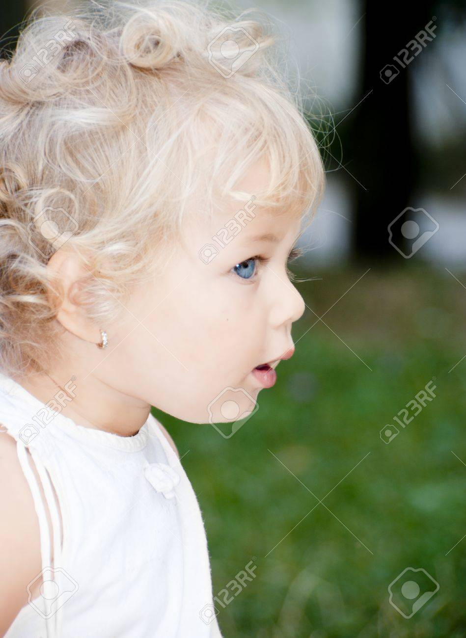 cute blond baby girl with blue eyes stock photo, picture and royalty