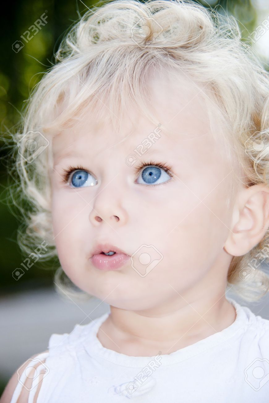 cute blond baby girl with blue eyes stock photo picture and royalty