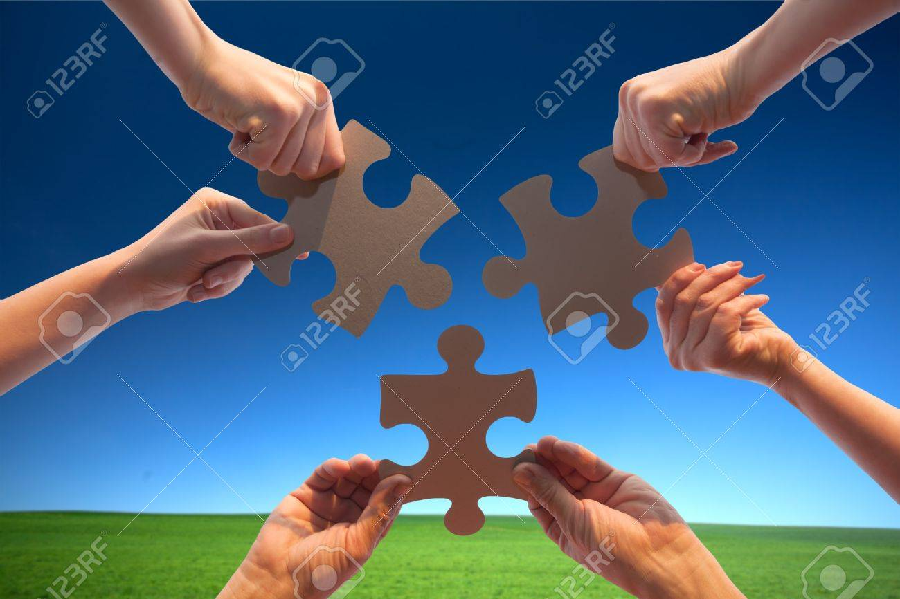 The hands holds puzzle on a background of the sky Stock Photo - 9952971