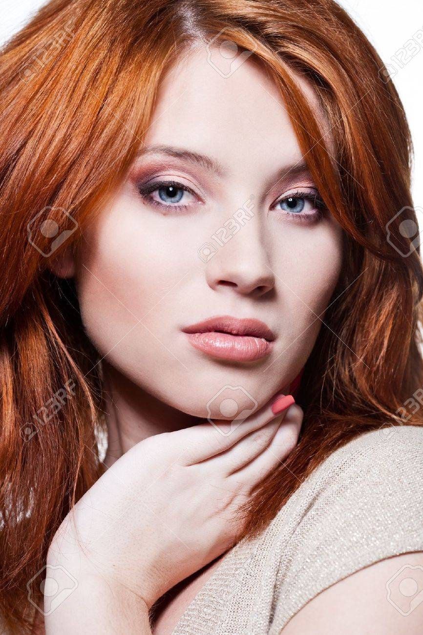 Closeup portrait of a sexy young woman with red hair and natural..