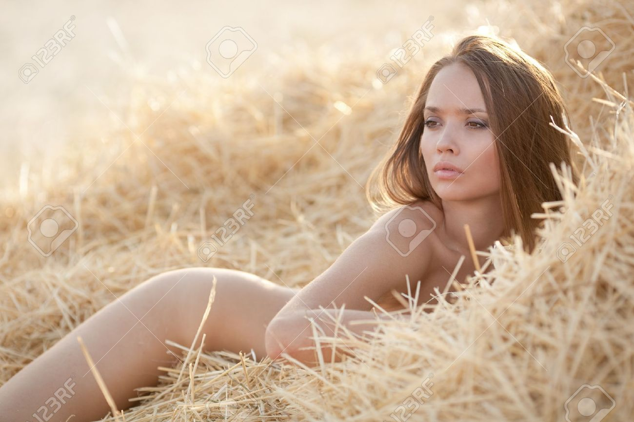 Young nude in hay
