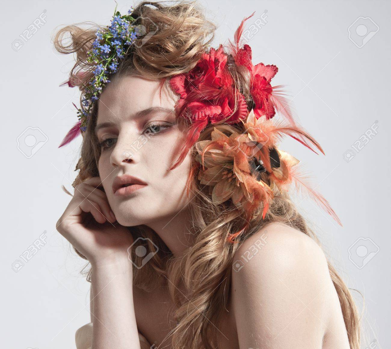 Stylized summer portrait of a young beautiful woman with flowers in stylized summer portrait of a young beautiful woman with flowers in her hair stok fotoraf izmirmasajfo Image collections