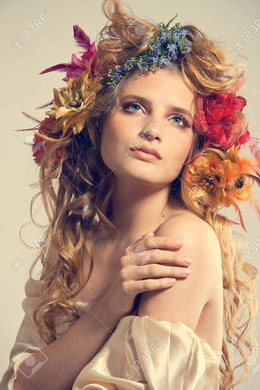 Stylized Summer Portrait Of A Young Beautiful Woman With Flowers