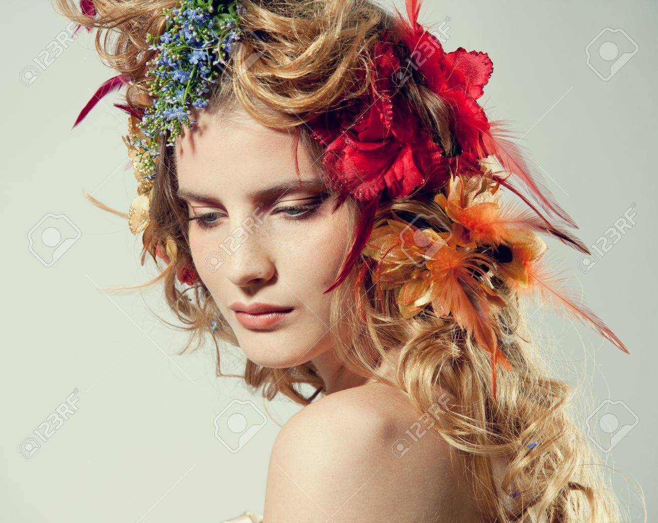 Stylized summer portrait of a young beautiful woman with flowers stylized summer portrait of a young beautiful woman with flowers in her hair stock photo izmirmasajfo Image collections