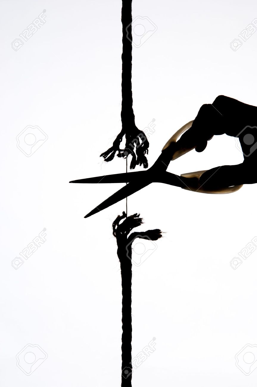 cutting a rope with a knife Stock Photo - 12881731