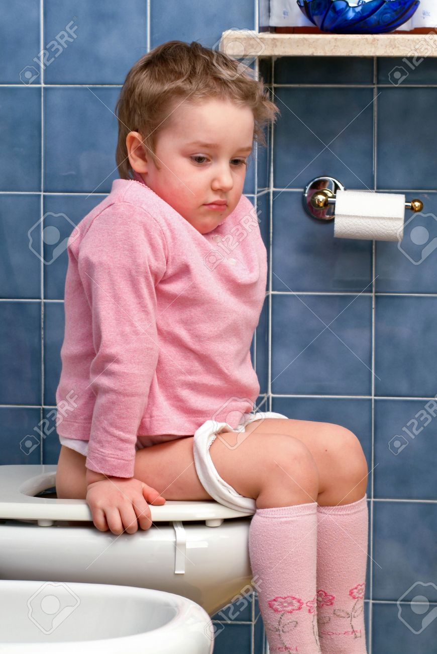 Little girl on the toilet that makes funny faces Stock Photo - 13203366