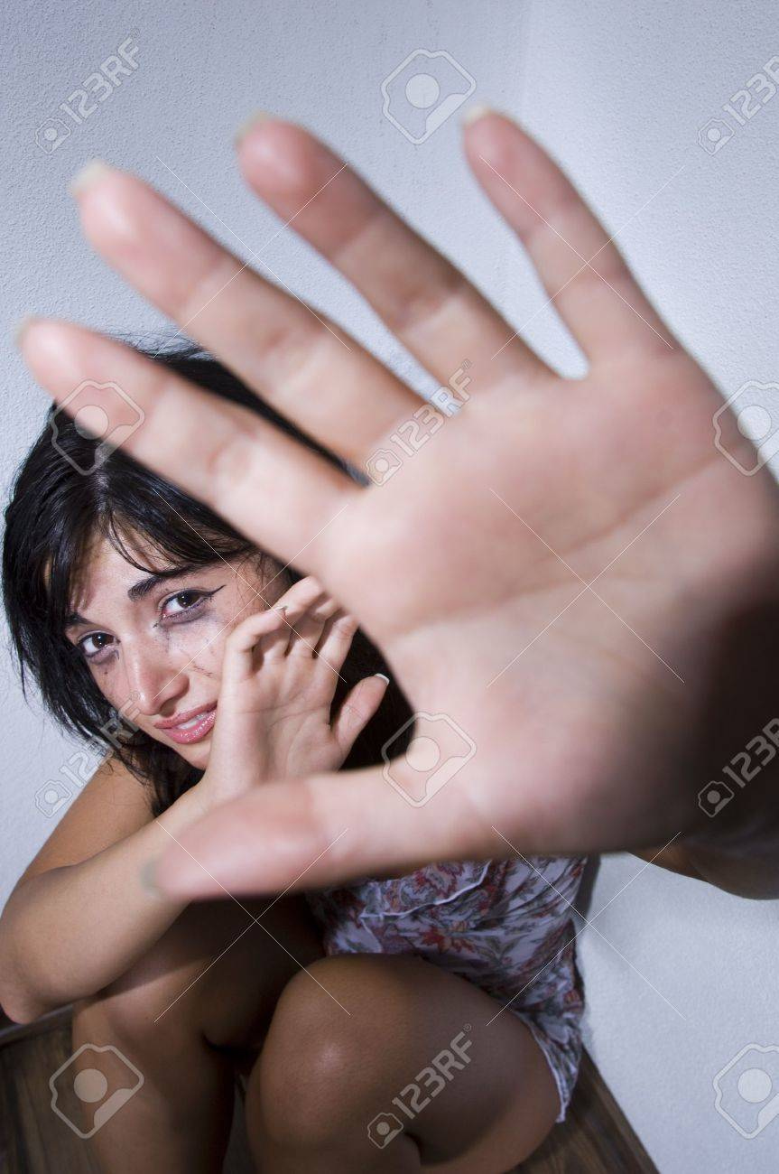 Woman terrorized by a stalker is defending himself with her arms protects Stock Photo - 13235381