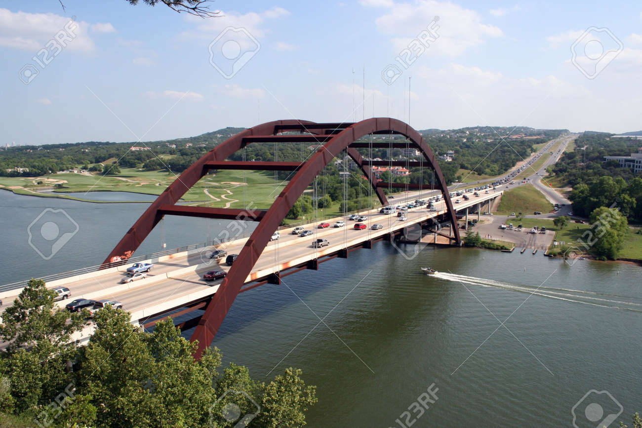 A shot of the Austin 360 Bridge on a clear calm day.  This is a very pretty picture of the bridge and a great symbol of Austin, Texas. Stock Photo - 394834
