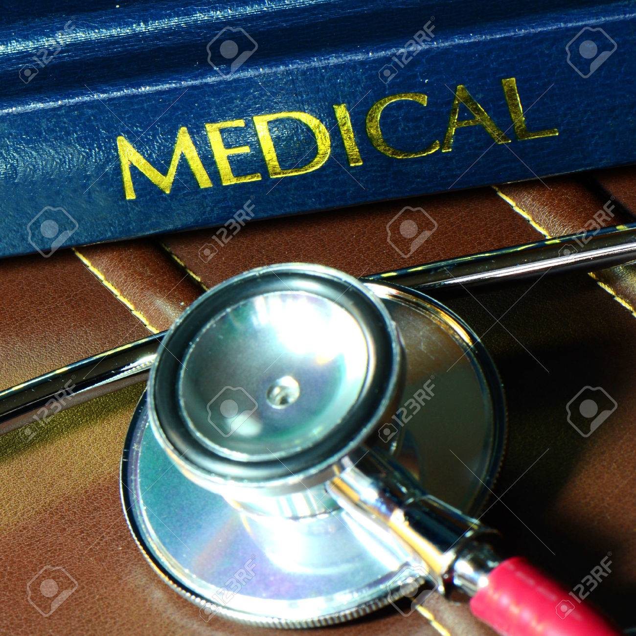 Stethoscope and medical text book on the doctor's desk Stock Photo - 23834806