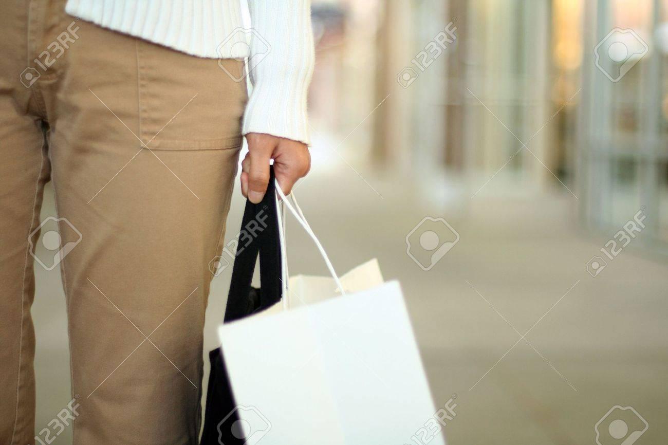 A woman shopping, carrying a bag Stock Photo - 394685