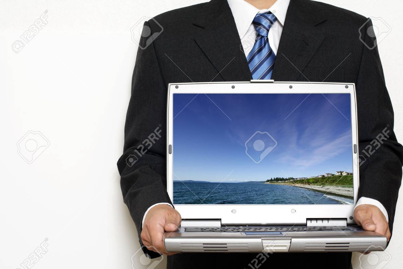Businessman holding his laptop Stock Photo - 448999