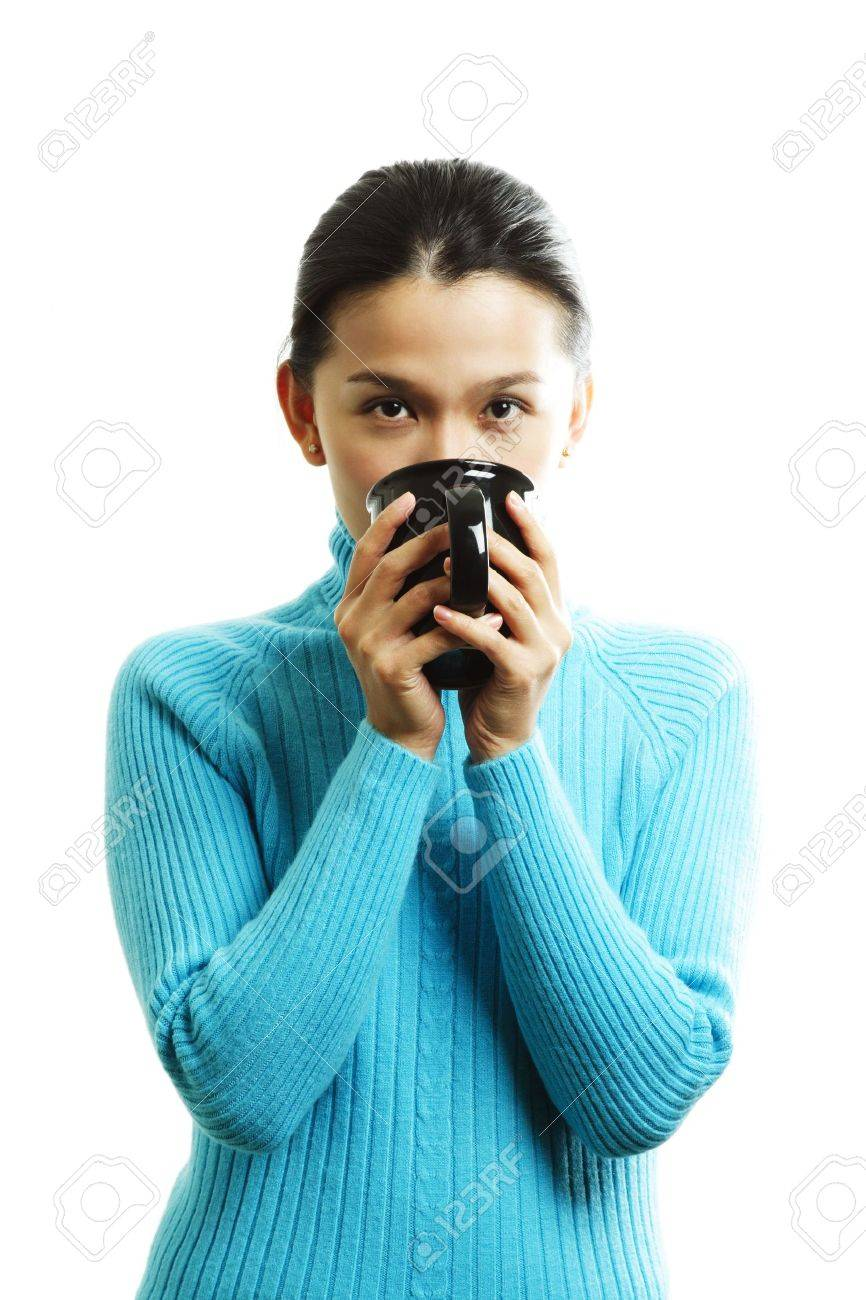 A pretty woman holding a cup of hot drink Stock Photo - 609224